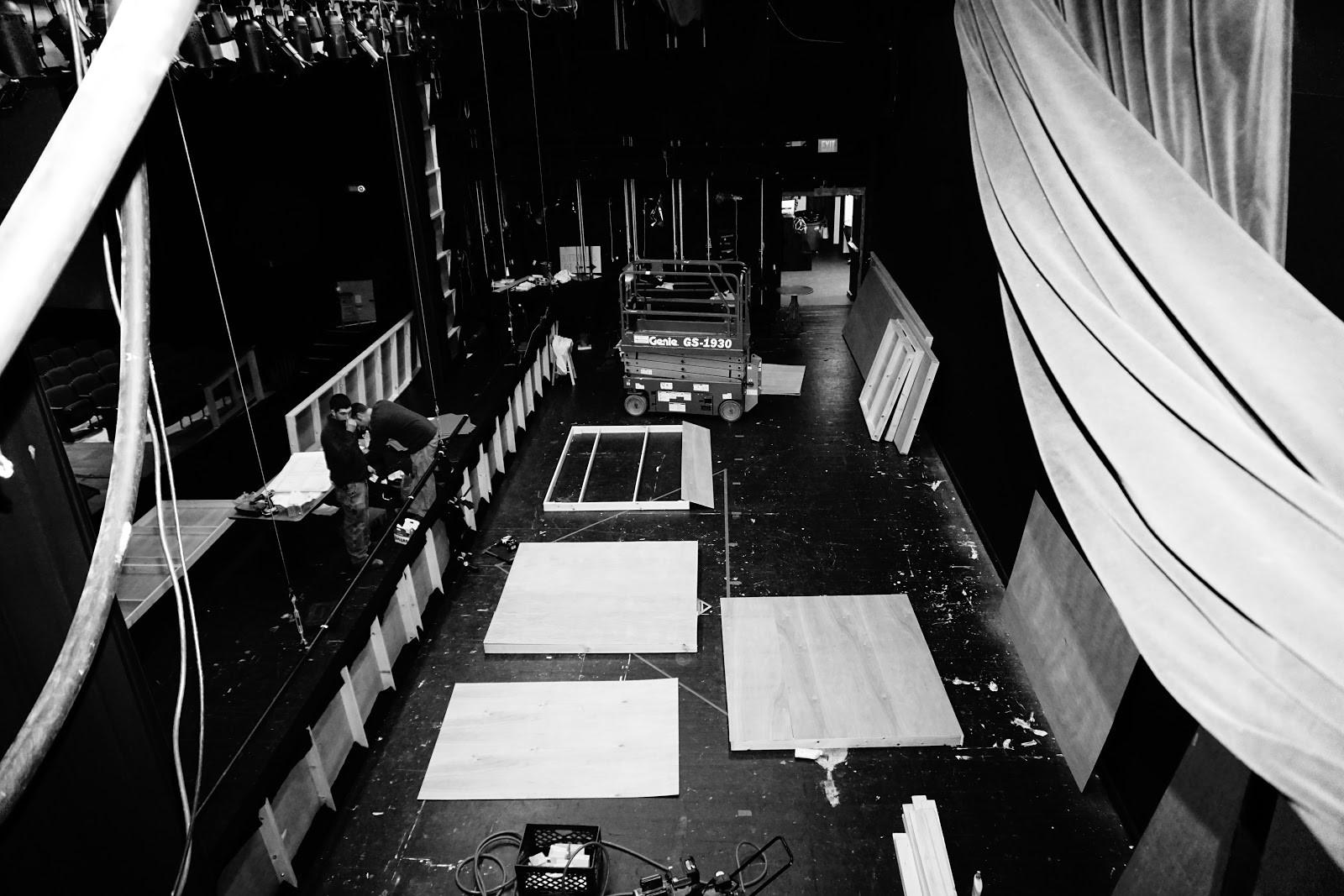 Stage+crew+Members+on+the+first+construction+weekend+Clean+the+theater+and+begin+building+borders+to+frame+the+set.+%0A