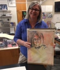 Julie shows off this year's beautifully done self-portrait.